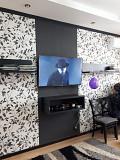 Установка телевизоров на стену при помощи кронштейнов Алматы
